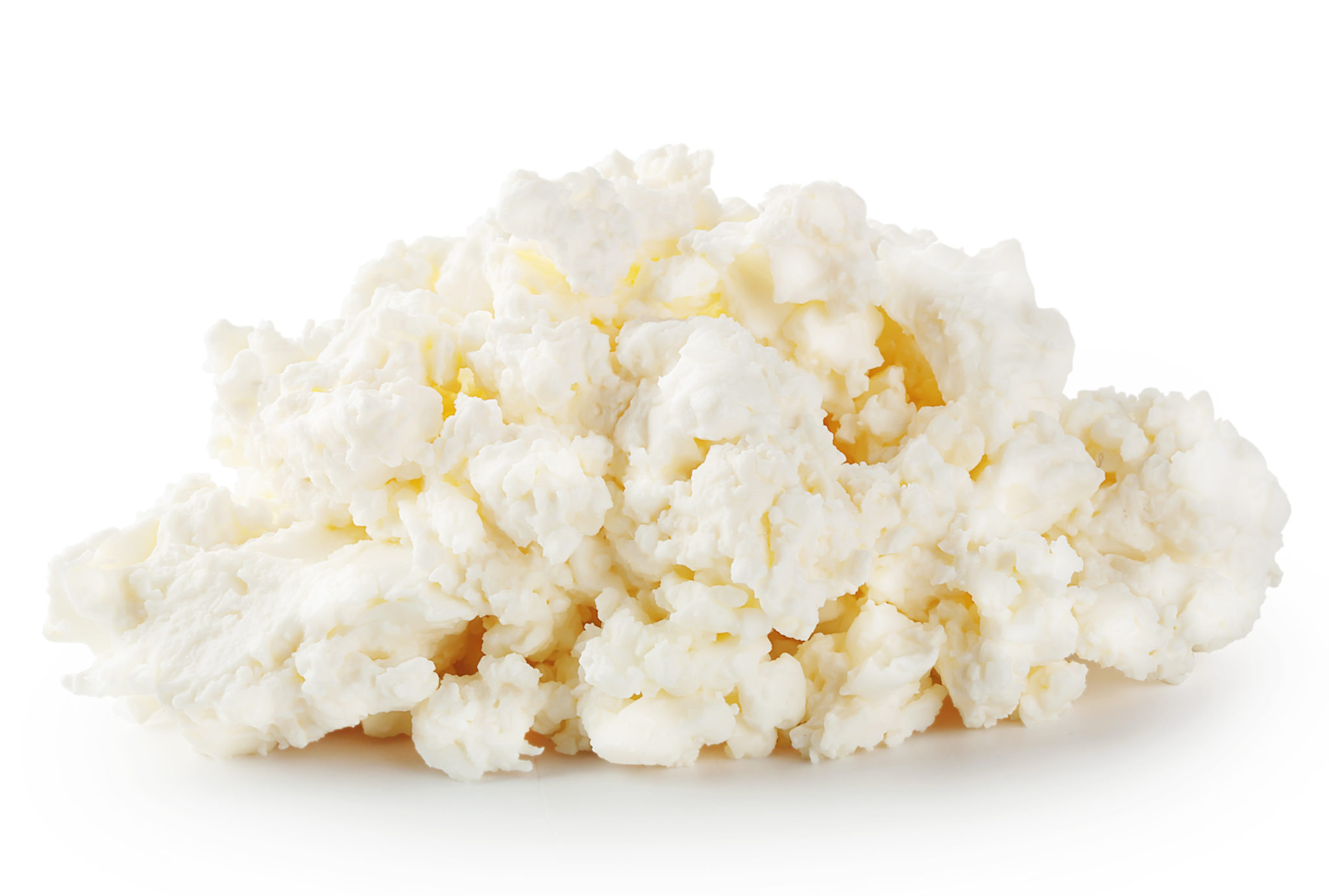 Fresh crumbly cheese isolated on white background